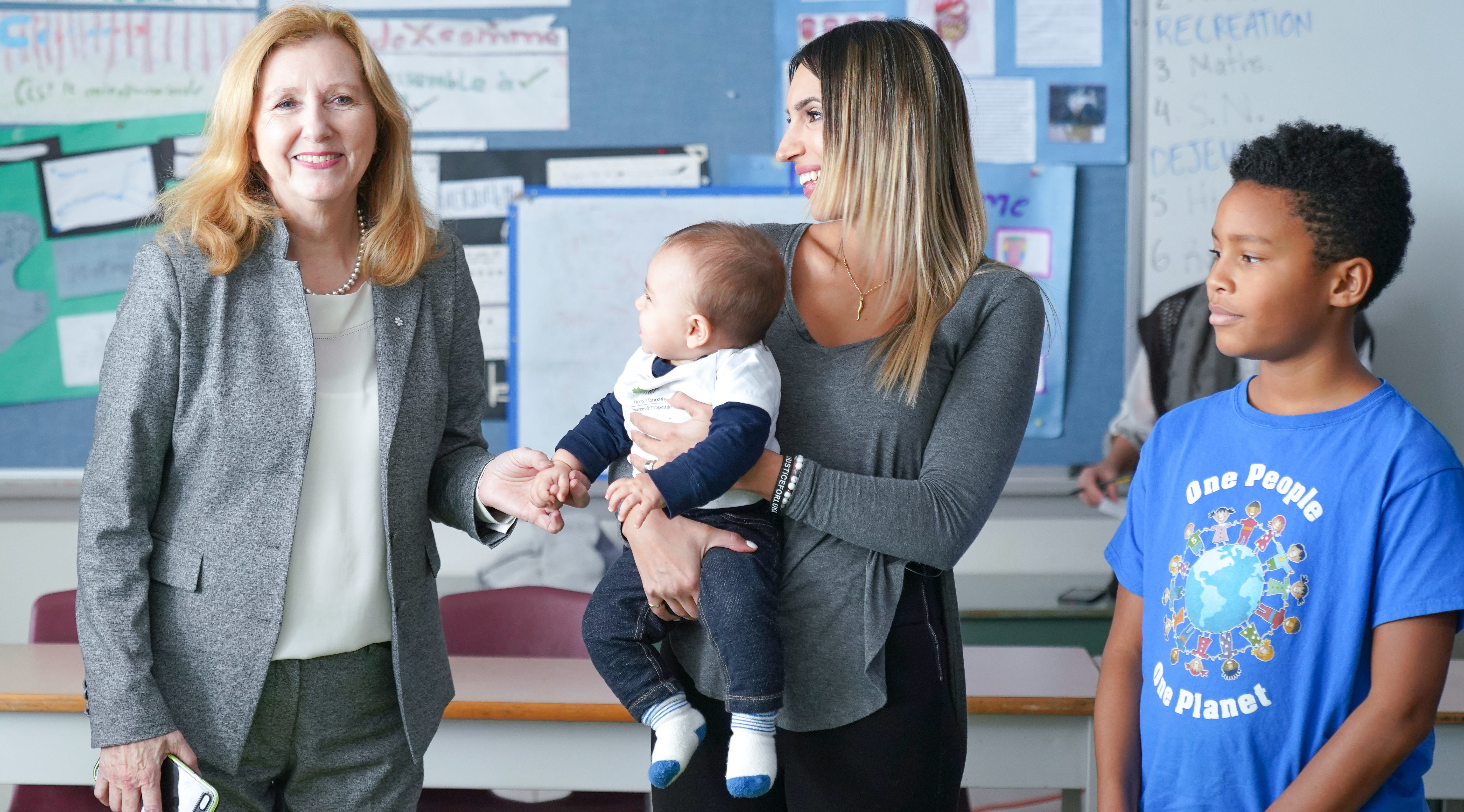 Mary Gordon, baby and mother, and a student in the classroom during a Roots of Empathy program